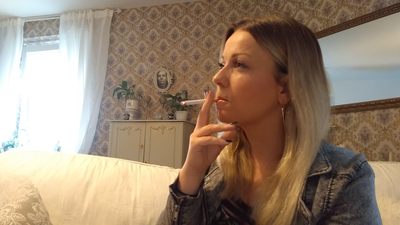 Lady Bella smokes a cigarette
