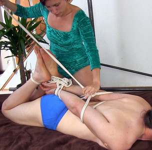 I'm tying this swimmer boy into a hogtie