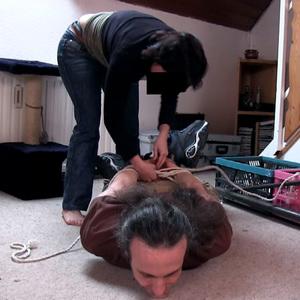 Buffalo boy tied up by a buffalo girl
