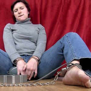 Getting an orgasm cuffed and smoking using massager