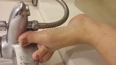 Feet playing with hose bath