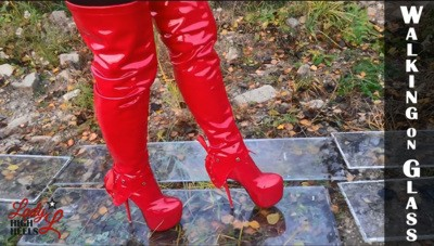 Walking in red over knee high boots on glass