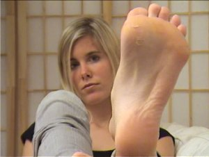 sweet girl takes off her socks