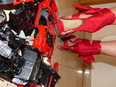 Crushing of Car Models with High Heels
