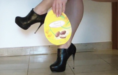 Crushing a chocolate box with high ankle boots