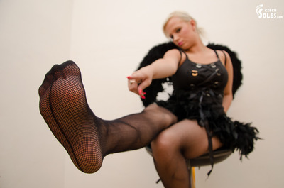 Black angel in fishnet stockings